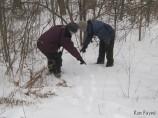 Carol Ramsayer and leader Barry King examining tracks
